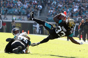 Chris Ivory #33 of the Jacksonville Jaguars leaps with the football during the second half of their game against the Houston Texans at EverBank Field on December 17, 2017 in Jacksonville, Florida.