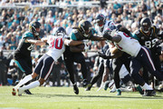 Chris Ivory #33 of the Jacksonville Jaguars runs with the football during the second half of their game against the Houston Texans at EverBank Field on December 17, 2017 in Jacksonville, Florida.