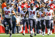 Chris Clark #74 of the Houston Texans reacts as he runs onto the field with teammates before a game against the New England Patriots at Gillette Stadium on September 24, 2017 in Foxboro, Massachusetts.