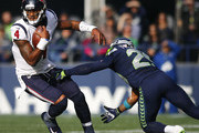 Quarterback Deshaun Watson #4 of the Houston Texans tries to escape free safety Earl Thomas #29 of the Seattle Seahawks during the second quarter of the game at CenturyLink Field on October 29, 2017 in Seattle, Washington.