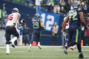 Free safety Earl Thomas #29 of the Seattle Seahawks returns an interception for a touchdown during the first quarter of the game against the Houston Texans at CenturyLink Field on October 29, 2017 in Seattle, Washington.