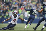 Quarterback Deshaun Watson #4 of the Houston Texans tries to tackle free safety Earl Thomas #29 of the Seattle Seahawks as Thomas returns an interception for a touchdown during the first quarter of the game at CenturyLink Field on October 29, 2017 in Seattle, Washington.