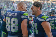 Tight end Jimmy Graham #88 of the Seattle Seahawks celebrates with tight end Nick Vannett #81after scoring the winning touchdown to beat the Houston Texans 41-38 at CenturyLink Field on October 29, 2017 in Seattle, Washington.