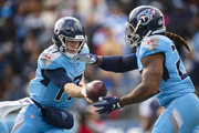 Ryan Tannehill #17 hands the ball off to Derrick Henry #22 of the Tennessee Titans during the first quarter against the Houston Texans at Nissan Stadium on December 15, 2019 in Nashville, Tennessee.