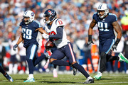 Braxton Miller #13 of the Houston Texans runs with the ball after a reception against the Tennessee Titans during the first half at Nissan Stadium on December 3, 2017 in Nashville, Tennessee.