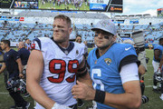 J.J. Watt #99 of the Houston Texans and Cody Kessler #6 of the Jacksonville Jaguars embrace after the end of the Houston Texans 20-7 victory over the Jacksonville Jaguars at TIAA Bank Field on October 21, 2018 in Jacksonville, Florida.