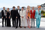 """(L-R) Howard Gertler, Philippa Goslett, Neil Gaiman, Aj Lewis, Alex Sharp, Elle Fanning, John Cameron Mitchell and Sandy Powell attend the """"How To Talk To Girls At Parties"""" photocall during the 70th annual Cannes Film Festival on May 21, 2017 in Cannes, France."""