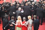 (From L) British novelist Neil Gaiman, British actor Alex Sharp, US actress Elle Fanning, US director John Cameron Mitchell, Australian actress Nicole Kidman and British actor Abraham Lewis pose for photographers as they leave on May 21, 2017 following the screening of the film 'How to talk to Girls at Parties' at the 70th edition of the Cannes Film Festival in Cannes, southern France.  / AFP PHOTO / Antonin THUILLIER