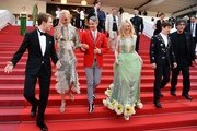 (FromL) British actor Abraham Lewis, Australian actress Nicole Kidman, US director John Cameron Mitchell, US actress Elle Fanning, British actor Alex Sharp and British author Neil Gaiman leave the Festival Palace on May 21, 2017 following the screening of the film 'How to talk to Girls at Parties' at the 70th edition of the Cannes Film Festival in Cannes, southern France.  / AFP PHOTO / Alberto PIZZOLI