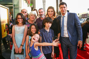 """Director Ken Marino (R) and family attend the premiere of """"How To Be A Latin Lover"""" on April 26, 2017 in Los Angeles, California."""