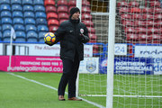 Referee Mike Dean tests the VAR in the goal before the Premier League match between Huddersfield Town and Crystal Palace at John Smith's Stadium on March 17, 2018 in Huddersfield, England.