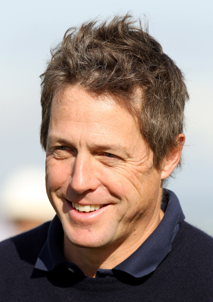 Hugh Grant Hollywood film star Hugh Grant in happy mood during the practice round of The Alfred Dunhill Links Championship at The Old Course on October 6, 2010 in St Andrews, Scotland.