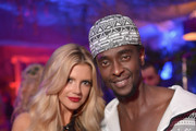 September 2014 Playmate Stephanie Branton and actor Edi Gathegi attends the Annual Midsummer Night's Dream Party at the Playboy Mansion hosted by Hugh Hefner on August 16, 2014 in Holmby Hills, California.