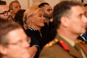 Australian actor and director Deborra-Lee Furness watches her husband Hugh Jackman's Order of Australia presentation by the Australian Governor General David Hurley at Government House on September 13, 2019 in Melbourne, Australia. Hugh Jackman was honoured for his service to the performing arts for his work as an advocate for poverty eradication.
