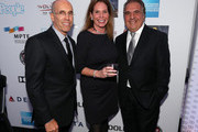 """(L-R) Jeffrey Katzenberg, CEO of DreamWorks Animation, and Chairman & Chief Executive Officer of Fox Filmed Entertainment Jim Gianopulos attend """"Hugh Jackman... One Night Only"""" Benefiting MPTF at Dolby Theatre on October 12, 2013 in Hollywood, California."""