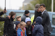 Hatem Ben Arfa of Hull City signs autographs for fans outside the stadium before the Barclays Premier League match between Hull City and Crystal Palace at KC Stadium on October 4, 2014 in Hull, England.