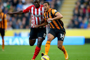Hatem Ben Arfa of Hull holds off Victor Wanyama of Southampton during the Barclays Premier League match between Hull City and Southampton at the KC Stadium on November 1, 2014 in Hull, England.