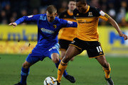 Joel Ekstrand of Watford and Jay Simpson of Hull City challenge for the ball during the npower Championship match between Hull City and Watford at KC Stadium on April 2, 2013 in Hull, England.