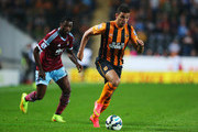 Hatem Ben Arfa of Hull City is chased by Alex Song of West Ham United during Barclays Premier League match between Hull City and West Ham United at KC Stadium on September 15, 2014 in Hull, England.