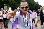 """A runner dressed as Elvis Presley poses for the camera after crossing the finish line of the Humana Rock """"n"""" Roll Chicago 5K on July 21, 2018 in Chicago, Illinois."""