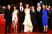 (L-R) Producer Jon Kilik, guest, actors Liam Hemsworth, Jennifer Lawrence, Josh Hutcherson, director Francis Lawrence and producer Nina Jacobson attend the 'The Hunger Games: Catching Fire' Premiere during The 8th Rome Film Festival at Auditorium Parco Della Musica on November 14, 2013 in Rome, Italy.