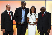 Usain Bolt (2nd L) of Jamaica and Allyson Felix (2nd R) of the United States pose with their male and female 2012 World Athletes of the Year awards next to President of the IAAF Lamine Diack (R) and Prince Albert II of Monaco during the IAAF athlete of the year awards at the IAAF Centenary Gala on November 24, 2012 in Barcelona, Spain.