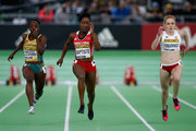 (L-R) Flings Owusu-Agyapong of Ghana, Kelly-Ann Baptiste of Trinidad and Tobago and Agata Forkasiewicz of Poland compete in the Women's 60 Metres Heats during day three of the IAAF World Indoor Championships at Oregon Convention Center on March 19, 2016 in Portland, Oregon.