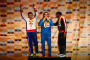 (L-R) Silver medallist Robert Grabarz of Great Britain, gold medallist Gianmarco Tamberi of Italy and bronze medallist Erik Kynard of the United States pose on the podium during the medal ceremony for the Men's High Jump during day three of the IAAF World Indoor Championships at Pioneer Courthouse Square on March 19, 2016 in Portland, Oregon.