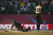 Usman Khawaja of Australia is run out by Grant Elliott of New Zealand during the ICC World Twenty20 India 2016 Super 10s Group 2 match between Australia and New Zealand at HPCA Stadium on March 18, 2016 in Dharamsala, India.