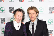 Laurie Anderson (L) and Willem Dafoe pose backstage durinig IFP's 27th Annual Gotham Independent Film Awards at Cipriani, Wall Street on November 26, 2018 in New York City.