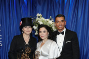 (L-R) Director Amy Sherman-Palladino, winner of Outstanding Writing and Directing for a Comedy Series for 'The Marvelous Mrs. Maisel', actor Alex Borstein, winner of Outstanding Supporting Actress in a Comedy Series for 'The Marvelous Mrs. Maisel', and IMDb Host Tim Kash attend IMDb LIVE After The Emmys 2018 on September 17, 2018 in Los Angeles, California.