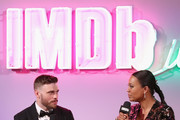 Aisha Tyler and Gus Kenworthy Photos Photo