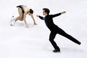 Jessica Dube (L) and Bryce Davison of Canada compete in the Pairs Short Program during the 2010 ISU World Figure Skating Championships on March 23, 2010 at the Palevela in Turin, Italy.