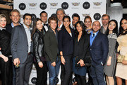 (L-R) Jamee Gidwitz, IVY co-founder Philipp Triebel, Sahm Adrangi, Kathryn Minshew, Cameron Silver, Zach Sims, Marcel Wanders, Melanie Whelan, Preston Konrad, Jessica Brillhart, Grace Atwood, IVY co-founder Beri Meric, Anson Mount, Jia Li, and Sharon Carpenter attend the IVY Innovator New York Dinner, presented by Cadillac on December 8, 2015 in New York City.