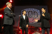 (L-R) IZOD Executive Vice President of Marketing, Mike Kelly, IZOD IndyCar Series Driver Dario Franchitti and Dancing with the Stars champion and IZOD IndyCar Series Driver Helio Castroneves take part in a celebration for the Indy 500 100th anniversary at an IZOD party at The Colony on April 13, 2011 in Los Angeles. The Indy 500 will take place on May 29, 2011 at the Indianapolis Motor Speedway.