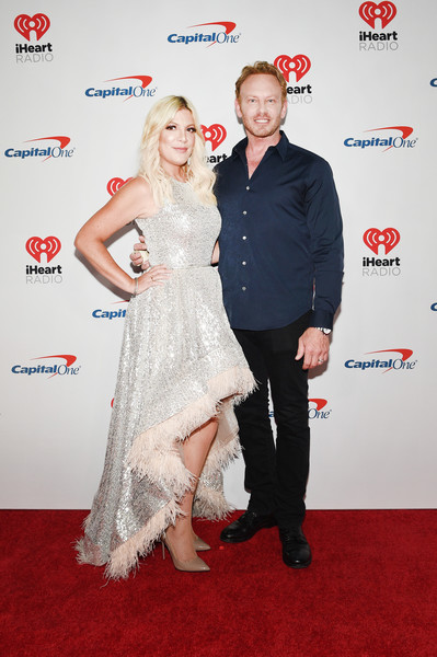 2019 iHeartRadio Music Festival - Night 1 – Press Room [red carpet,carpet,red,dress,premiere,flooring,fashion,event,gown,cocktail dress,ian ziering,tori spelling,l-r,press room,las vegas,nevada,t-mobile arena,iheartradio music festival]