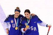 Gold medal winners Meghan Duggan #10 and Hilary Knight #21 of the United States celebrate during the victory ceremony after defeating Canada in a shootout in the Women's Gold Medal Game on day thirteen of the PyeongChang 2018 Winter Olympic Games at Gangneung Hockey Centre on February 22, 2018 in Gangneung, South Korea.