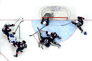 Jussi Jokinen #36 of Finland tries to shoot against Brooks Orpik #44, Patrick Kane #88, Jonathan Quick #32, Ryan Kesler #17, Zach Parise #9 and Ryan McDonagh #27 of the United States during the Men's Ice Hockey Bronze Medal Game on Day 15 of the 2014 Sochi Winter Olympics at Bolshoy Ice Dome on February 22, 2014 in Sochi, Russia.