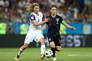 Birkir Bjarnason of Iceland battles for possession with Luka Modric of Croatia during the 2018 FIFA World Cup Russia group D match between Iceland and Croatia at Rostov Arena on June 26, 2018 in Rostov-on-Don, Russia.