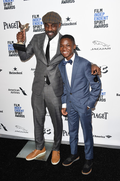 2016 Film Independent Spirit Awards - Press Room [beasts of no nation,suit,formal wear,white-collar worker,event,tuxedo,premiere,idris elba,abraham attah,award,costar,best supporting male,room,press room,l,film independent spirit awards]