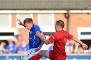 James Reid (R) of Ilkeston tackles Marc Albrighton of Leicester City during the pre season friendly match between Ilkeston and Leicester City at the New Manor Ground on July 22, 2014 in Ilkeston, England.