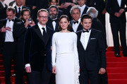 """(L-R) Director James Gray, actors Marion Cotillard and Jeremy Renner leave """"The Immigrant"""" Premiere during the 66th Annual Cannes Film Festival at Grand Theatre Lumiere on May 24, 2013 in Cannes, France."""