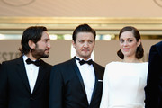 """Actors Jeremy Renner and Marion Cotillard attend """"The Immigrant"""" Premiere during the 66th Annual Cannes Film Festival at Grand Theatre Lumiere on May 24, 2013 in Cannes, France."""