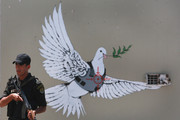 Banksy Decorated Israel's Walls with Beautiful New Graffiti
