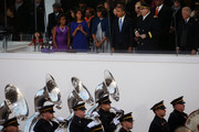 (L-R) Sasha Obama, Malia Obama, first lady Michelle Obama, U.S. President Barack Obama,  U.S. Chief of Staff of the Army General Raymond Odierno and U.S. Vice President Joe Biden watch from the reviewing stand as the presidential inaugural parade winds through the nation's capital January 21, 2013 in Washington, DC. Barack Obama was ceremonially sworn in for a second term as President of the United States.