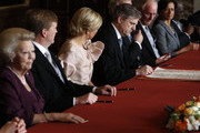 Prince Willem-Alexander of the Netherlands (2nd-L) sits alongside his wife Princess Maxima of the Netherlands (3rd-R) during the abdication ceremony of his mother Queen Beatrix of the Netherlands (L) in the Moseszaal at the Royal Palace on April 30, 2013 in Amsterdam. Queen Beatrix of the Netherlands is abdicating the throne after a 33 year reign and hands the throne to her son Prince Willem-Alexander who will be sworn in later at the Nieuwe Kerk ahead of a joint session of parliament.