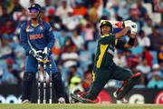 Mahendra Singh Dhoni of India watches on as Shoaib Malik hits out during The ICC Champions Trophy Group A Match between India and Pakistan on September 26, 2009 at The Supersport Stadium in Centurion, South Africa.
