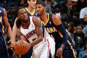 Paul George #24 of the Indiana Pacers defends against DeMarre Carroll #5 of the Atlanta Hawks at Philips Arena on January 8, 2014 in Atlanta, Georgia.  NOTE TO USER: User expressly acknowledges and agrees that, by downloading and or using this photograph, User is consenting to the terms and conditions of the Getty Images License Agreement.