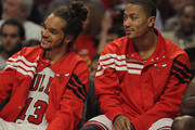 Joakim Noah #13 (L) and Derrick Rose #1 of the Chicago Bulls enjoy watching teammates take on the Indiana Pacers at the United Center on March 5, 2012 in Chicago, Illinois. The Bulls defeated the Pacers 92-72. NOTE TO USER: User expressly acknowledges and agrees that, by downloading and or using this photograph, User is consenting to the terms and conditions of the Getty Images License Agreement.