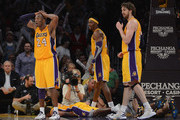 Kobe Bryant #24, Dwight Howard #12 and Pau Gasol #16 of the Los Angeles Lakers react to a blocking foul on Chris Duhon #21 during the game against the Indiana Pacers at Staples Center on November 27, 2012 in Los Angeles, California.  NOTE TO USER: User expressly acknowledges and agrees that, by downloading and or using this photograph, User is consenting to the terms and conditions of the Getty Images License Agreement.  The Pacers won 79-77.
